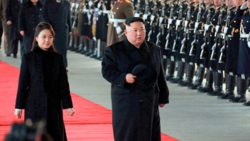 """In this Monday, Jan. 7, 2019, photo provided on Tuesday, Jan. 8, 2019 by the North Korean government, North Korean leader Kim Jong Un walks with his wife Ri Sol Ju at Pyongyang Station in Pyongyang, North Korea, before leaving for China. Kim left for China for a four-day trip, the North's state media reported Tuesday, amid speculation that he may attempt to coordinate his positions with Beijing ahead of his likely summit with U.S. President Donald Trump. Independent journalists were not given access to cover the event depicted in this image distributed by the North Korean government. The content of this image is as provided and cannot be independently verified. Korean language watermark on image as provided by source reads: """"KCNA"""" which is the abbreviation for Korean Central News Agency. (Korean Central News Agency/Korea News Service via AP)"""