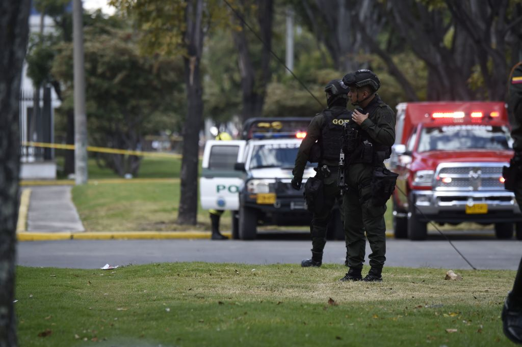 """Security forces work at the site of an apparent car bomb attack on a police cadet training school in Bogota, that left at least four people dead and 10 injured on January 17, 2019. - """"It seems there was a car bomb inside the General Santander School,"""" said the city's mayor, Enrique Penalosa. (Photo by JUAN BARRETO / AFP) (Photo credit should read JUAN BARRETO/AFP/Getty Images)"""