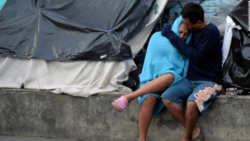 """Venezuelan migrants remain at an improvised camp near a bus terminal in Bogota on November 13, 2018. - Venezuelans migrants are transferred voluntarily to a humanitarian provisional shelter by Bogota's Town Hall, the first city to announce an """"Integral Plan of Attention for Venezuelans"""", to offer social and humanitarian services. As reported by the United Nations Organization for Migration (IOM) and the United Nations High Commissioner for Refugees (UNHCR), refugees and migrants from Venezuela around the world have reached three million. (Photo by Raul ARBOLEDA / AFP)RAUL ARBOLEDA/AFP/Getty Images"""
