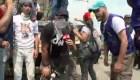 Voluntarios se resguardan de ataques de la Policía Nacional Bolivariana