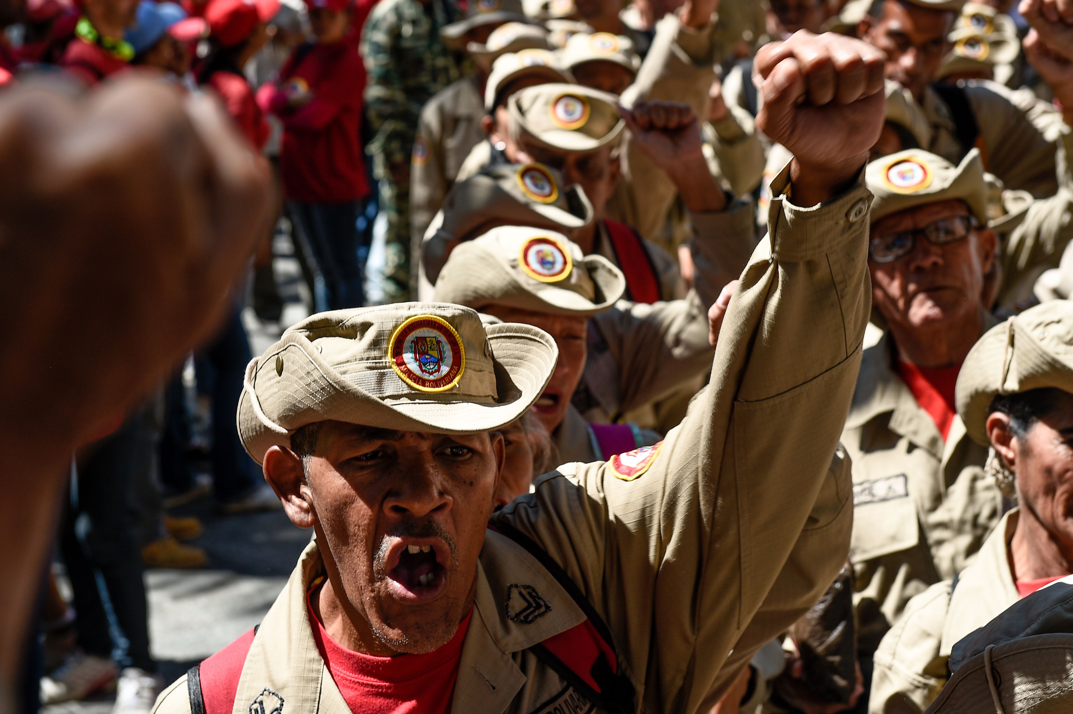 """Members of Venezuela's Bolivarian militia demonstrate in support of President Nicolas Maduro during a commemoration for the """"27th Anniversary of the Military Rebellion of the 4FEB92 and National Dignity Day"""", at Bolivar Square in Caracas, on February 4, 2019. - The United Nations will not join any group of nations promoting initiatives to resolve the crisis in Venezuela, the UN chief said Monday, indicating he will not attend a meeting in Uruguay this week of several countries. Mexico and Uruguay had hoped that UN Secretary-General Antonio Guterres would attend a conference in Montevideo on Thursday aimed at promoting dialogue between Venezuela's President Nicolas Maduro and opposition leader Juan Guaido. (Photo by Federico PARRA / AFP)        (Photo credit should read FEDERICO PARRA/AFP/Getty Images)"""