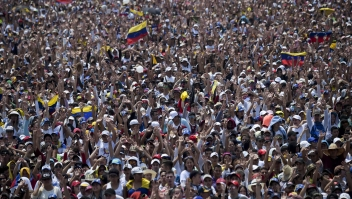 """People attend """"Venezuela Aid Live"""" concert, organized to raise money for the Venezuelan relief effort at Tienditas International Bridge in Cucuta, Colombia, on February 22, 2019. - Venezuela's political tug-of-war morphs into a battle of the bands on Friday, with dueling government and opposition pop concerts ahead of a weekend showdown over the entry of badly needed food and medical aid. (Photo by RAUL ARBOLEDA / AFP) (Photo credit should read RAUL ARBOLEDA/AFP/Getty Images)"""