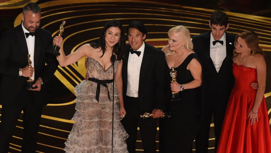 """The crew of """"Free Solo"""" accepts the Oscar for Best Documentary during the 91st Annual Academy Awards at the Dolby Theatre in Hollywood, California on February 24, 2019. (Photo by VALERIE MACON / AFP) (Photo credit should read VALERIE MACON/AFP/Getty Images)"""