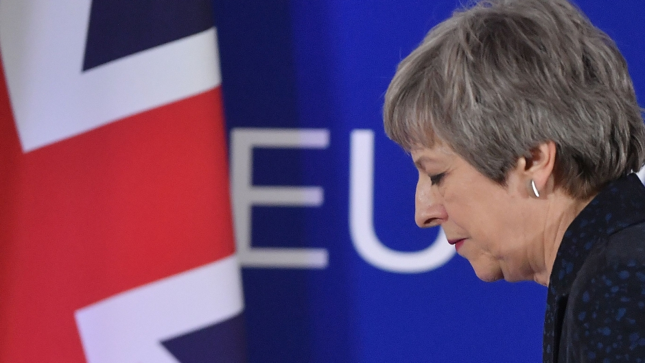 British Prime Minister Theresa May walks after holding a press conference on March 22, 2019, on the first day of an EU summit focused on Brexit, in Brussels. - European Union leaders meet in Brussels on March 21 and 22, for the last EU summit before Britain's scheduled exit of the union. (Photo by Emmanuel DUNAND / AFP) (Photo credit should read EMMANUEL DUNAND/AFP/Getty Images)