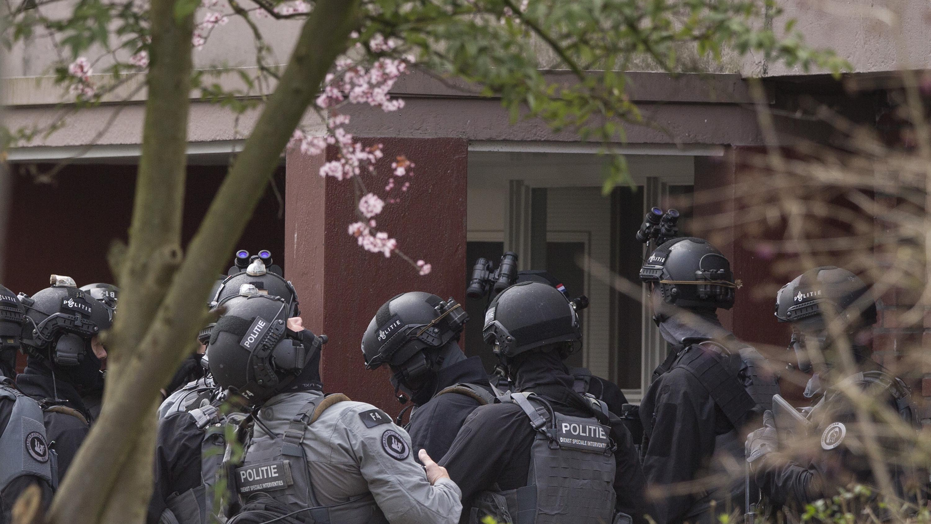 """Dutch counter terrorism police prepare to enter a house after a shooting incident in Utrecht, Netherlands, Monday, March 18, 2019. Police in the central Dutch city of Utrecht say on Twitter that """"multiple"""" people have been injured as a result of a shooting in a tram in a residential neighborhood. (AP Photo/Peter Dejong)"""