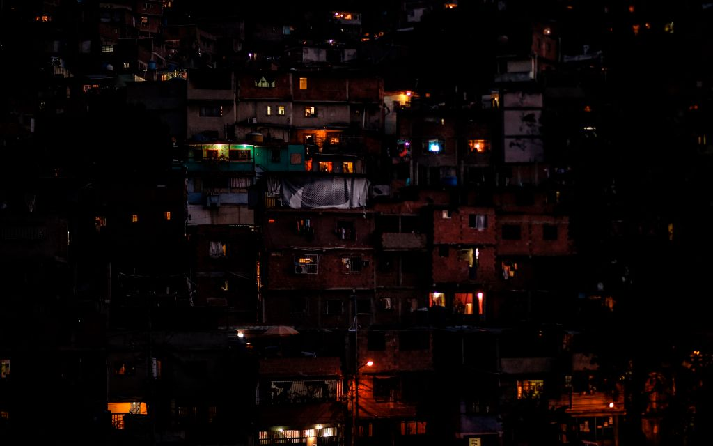 TOPSHOT - Partial view of the neighborhood Petare hill -where electric power has been restored- on March 10, 2019, during the third day of a massive power outage which has left the capital and much of the country without communications, water and electricity. - The unprecedented power outage threatens to extend indefinitely, increasing distress for the severe political and economic crisis hitting the oil-rich South American nation. (Photo by Juan BARRETO / AFP) (Photo credit should read JUAN BARRETO/AFP/Getty Images)