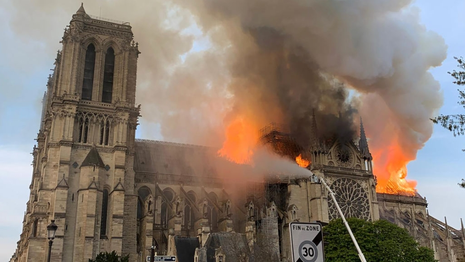 Flames and smoke are seen billowing from the roof at Notre-Dame Cathedral in Paris on April 15, 2019. - A fire broke out at the landmark Notre-Dame Cathedral in central Paris, potentially involving renovation works being carried out at the site, the fire service said.Images posted on social media showed flames and huge clouds of smoke billowing above the roof of the gothic cathedral, the most visited historic monument in Europe. (Photo by Patrick ANIDJAR / AFP) (Photo credit should read PATRICK ANIDJAR/AFP/Getty Images) FRANCE-FIRE-NOTRE DAME