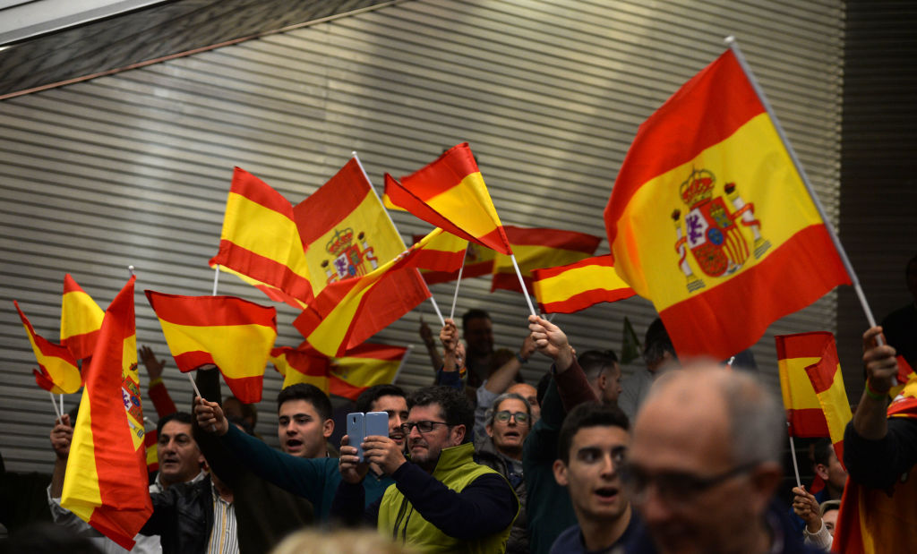 Far-right party Vox supporters wave Spanish flags during campaign rally in Seville on April 24, 2019 ahead of the April 28 general election. (Photo by CRISTINA QUICLER / AFP) (Photo credit should read CRISTINA QUICLER/AFP/Getty Images)