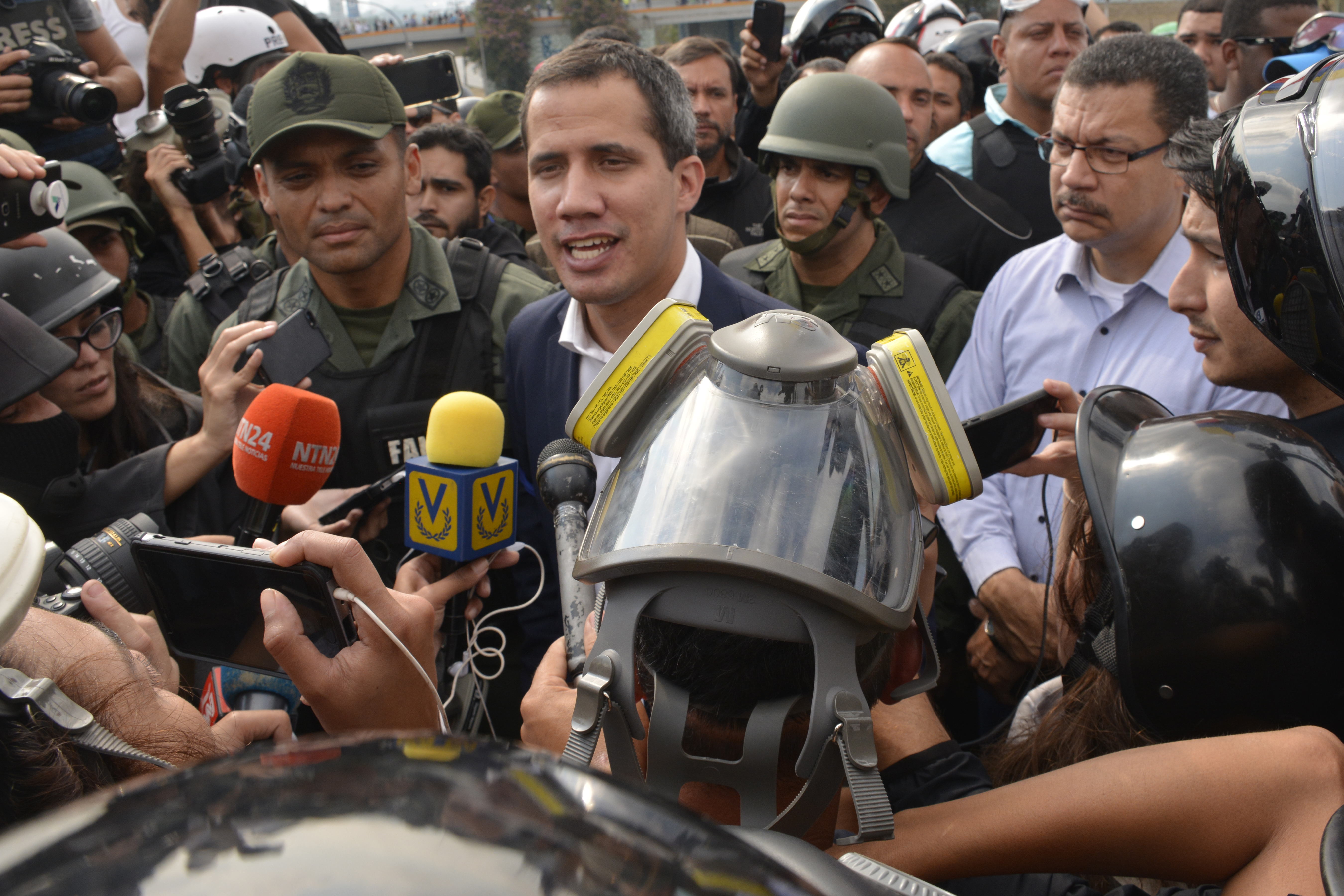 CARACAS, VENEZUELA - APRIL 30: Venezuelan opposition leader Juan Guaidó, recognized by many members of the international community as the country's rightful interim ruler, talks to media out of airforce base La Carlota on April 30, 2019 in Caracas, Venezuela. Through a live broadcast via social media, Venezuelan opposition leader Juan Guaido called for a military uprising against the government of Nicolás Maduro. He declared to be at the air base of La Carlota and was seen surrounded by soldiers and opposition activist Leopoldo Lopez, who was under house arrest. (Photo by Rafael Briceno/Getty Images)