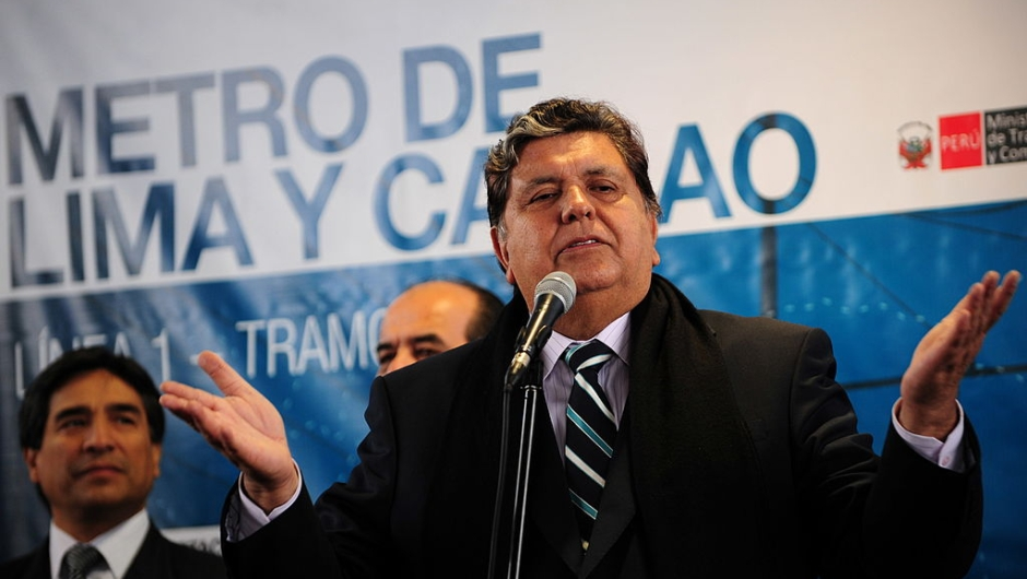 Peruvian President Alan Garcia speaks to the media during the inauguration of the first section for the electric train in Lima on July 11, 2011. AFP PHOTO/ERNESTO BENAVIDES (Photo credit should read ERNESTO BENAVIDES/AFP/Getty Images)