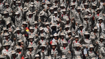 TOPSHOT - Members of Venezuela's Bolivarian Militia attend a pro-government rally on May Day in Caracas on May 1, 2019. - Pro- and anti-government rallies were due to take place in Venezuela, a day after violent clashes erupted in the capital following opposition leader Juan Guido's call on the military to rise up against Maduro, who claimed the insurrection had failed. (Photo by Yuri CORTEZ / AFP) (Photo credit should read YURI CORTEZ/AFP/Getty Images)
