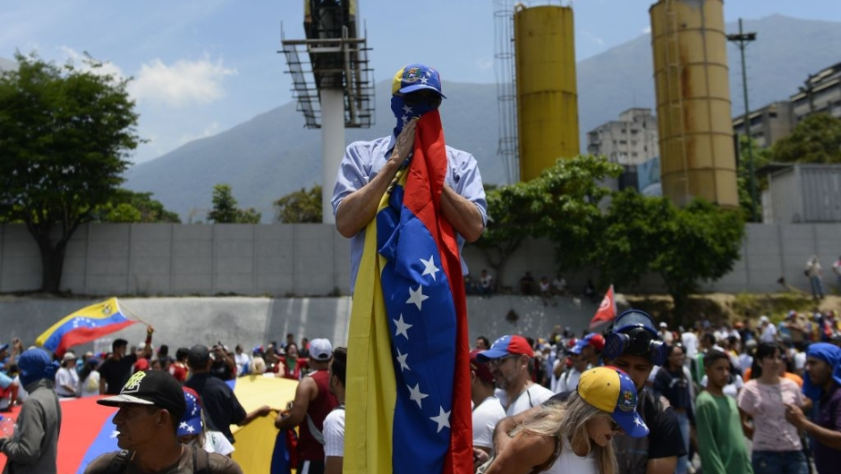 Anti-government demonstrators rally in Caracas to commemorate May Day on May 1, 2019 after a day of violent clashes on the streets of the capital spurred by Venezuelan opposition leader Juan Guaido's call on the military to rise up against President Nicolas Maduro. - Guaido called for a massive May Day protest to increase the pressure on President Maduro. (Photo by Matias Delacroix / AFP) (Photo credit should read MATIAS DELACROIX/AFP/Getty Images)