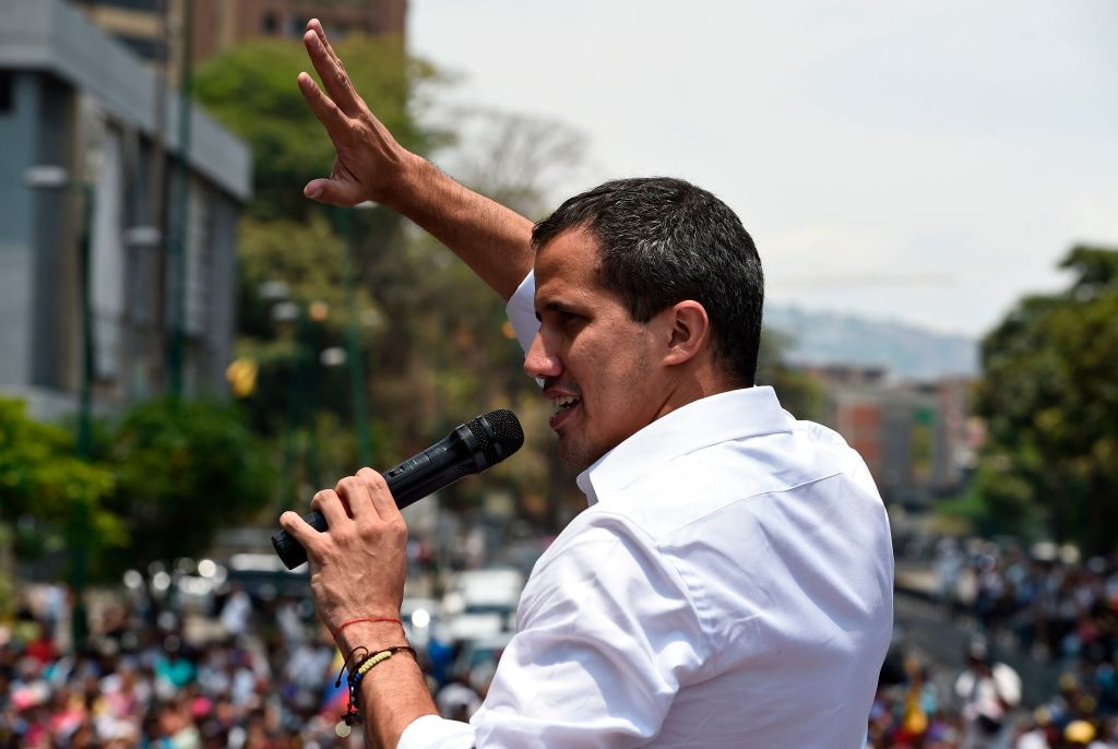 Venezuelan opposition leader Juan Guaido delivers a speech to supporters during a rally to commemorate May Day on May 1, 2019 after a day of violent clashes on the streets of the capital spurred by his call on the military to rise up against President Nicolas Maduro. - Guaido called for a massive May Day protest to increase the pressure on President Maduro. (Photo by Federico PARRA / AFP) (Photo credit should read FEDERICO PARRA/AFP/Getty Images)