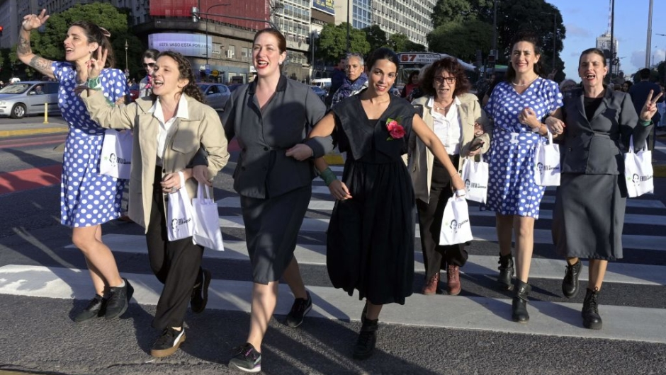 """Women fancy dressed as former Argentina's First Lady (1946-1952) Eva Peron (1919-1952), pose at the Republic square during a demonstration in Buenos Aires on May 6, 2019. - May 7th marks the 100th anniversary of Eva Duarte de Peron's (Evita) birth, who was called the """"standard-bearer of the humble"""". (Photo by JUAN MABROMATA / AFP) (Photo credit should read JUAN MABROMATA/AFP/Getty Images)"""