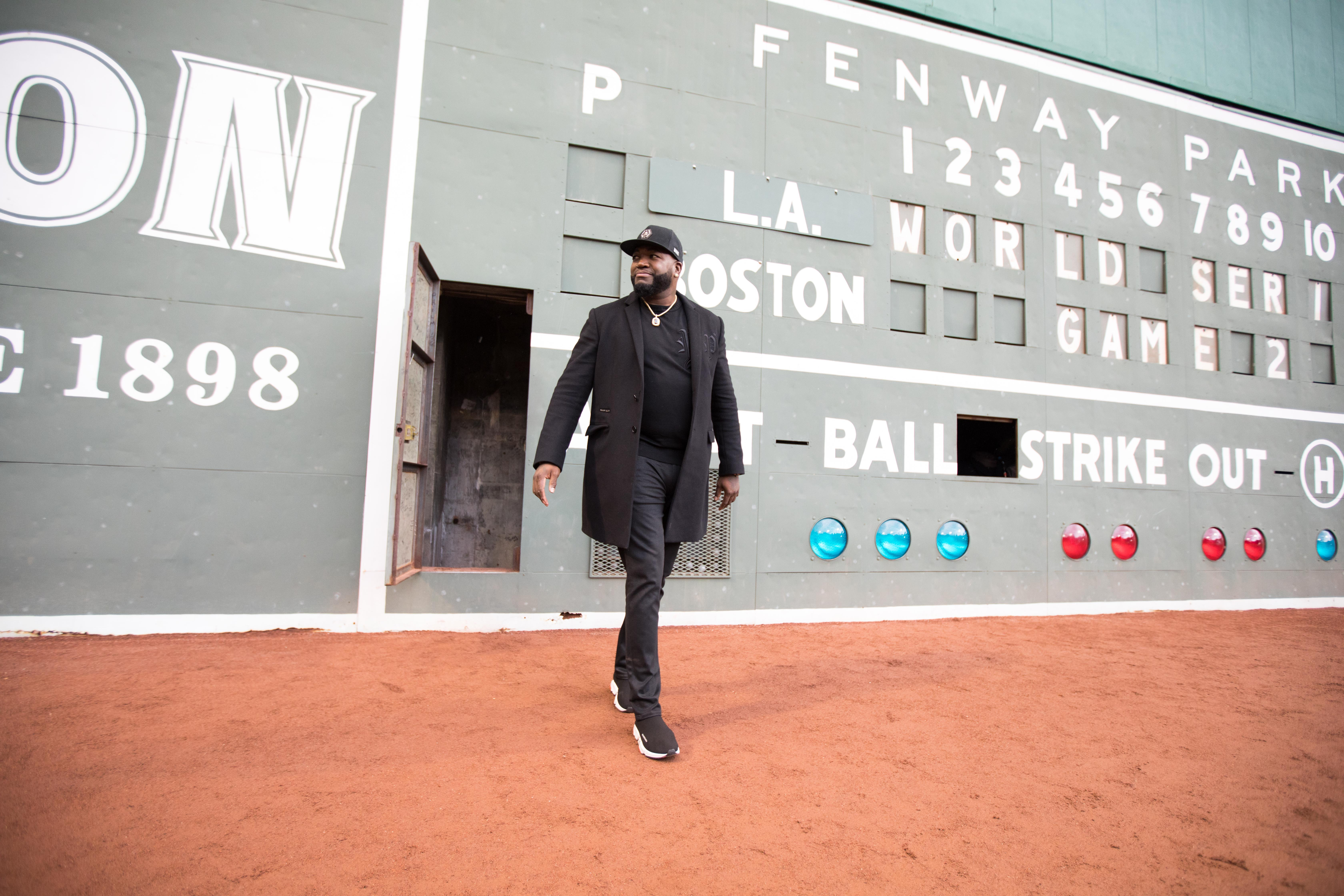 BOSTON, MA - OCTOBER 24: Mastercard and David Ortiz surprise Red Sox fans from inside Fenway Parks Green Monster before Game 2 of the MLB World Series on October 24, 2018 in Boston, Massachusetts. (Photo by Scott Eisen/Getty Images for Mastercard)
