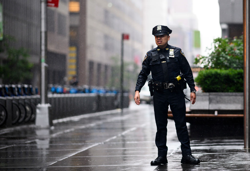 """A policeman looks down a street after a helicopter crash-landed on top of a building in midtown Manhattan in New York on June 10, 2019. - Speaking at the scene New York Governor Andrew Cuomo told reporters there had been """"casualties"""" on board the helicopter, but that no one in the building had been hurt. (Photo by Johannes EISELE / AFP) (Photo credit should read JOHANNES EISELE/AFP/Getty Images)"""