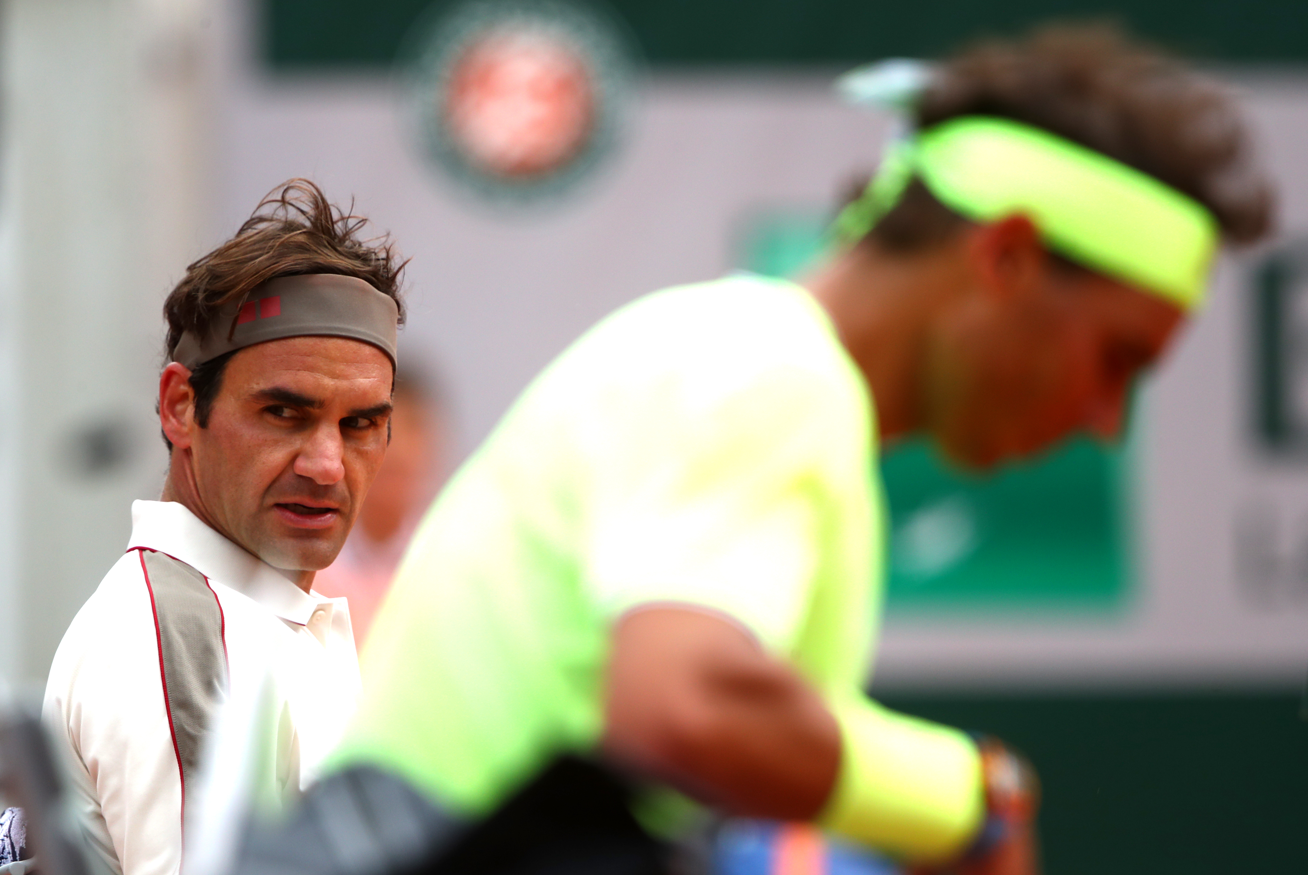 PARIS, FRANCE - JUNE 07: Rafael Nadal of Spain and Roger Federer of Switzerland in the mens singles semi-final during Day thirteen of the 2019 French Open at Roland Garros on June 07, 2019 in Paris, France. (Photo by Julian Finney/Getty Images)