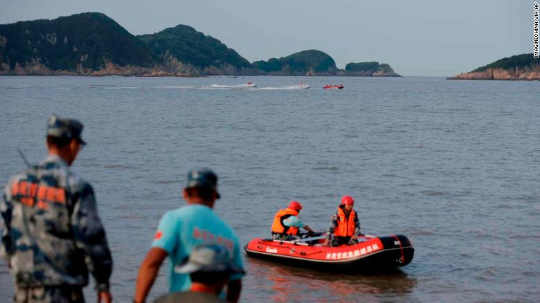 Chinese rescuers search for the 9-year-old missing girl Zhang Zixin, who was taken by a couple who later committed suicide, along the seacoast in Xiangshan county, Ningbo city, east China's Zhejiang province, 11 July 2019. The resident card of a missing girl taken away by two tenants in her home at Hangzhou was found along the Xiangshan coastline in Ningbo by search and rescue staff on Wednesday night, Qianjiang Evening News reported. Resident card issued by Hangzhou authorities can be used to travel on buses and subways or to access social security services or in libraries and parks. Hundreds of people including Xiangshan police and civilian rescue teams have taken part in the search on the sea and nearby mountains. The search scope has been narrowed to 2 kilometers along the coastline. (Imaginechina via AP Images)