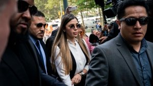 """NEW YORK, NY - JULY 17: Emma Coronel Aispuro, wife of Joaquin """"El Chapo"""" Guzman, is surrounded by security as she arrives at federal court on July 17, 2019 in New York City. El Chapo was found guilty on all charges in a drug conspiracy trial and will be sentenced this morning. (Photo by Drew Angerer/Getty Images)"""