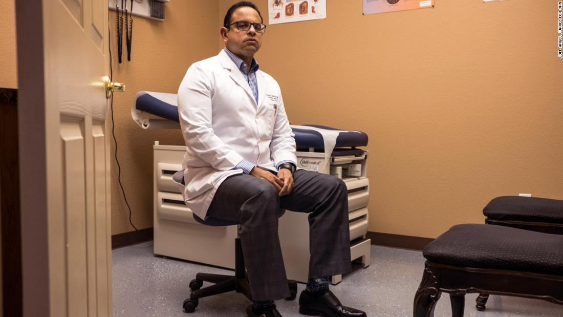 """Jose Burgos, 38, an internal medicine physician, poses for a portrait at the El Paso Medical Research Institute in El Paso, Texas, Tuesday, Aug. 6, 2019. Burgos initially moved from Venezuela to El Paso more than 20 years ago to complete his post-graduate degree. He says he decided to stay in El Paso because of how safe it is. """"You feel helpless. My concern as a Hispanic is that if they don't acknowledge that this part of the country and this part of the community is afraid and feel that we are racially attacked verbally and now physically, then at some point somebody is going to have a response to that and it's not going to be friendly response,"""" Burgos said. """"We need our leaders from any party to acknowledge the problem and bring us together. """""""