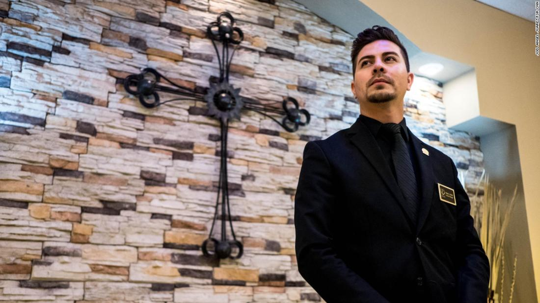 Jorge A. Diaz, 28, general manager at Perches Funeral Homes, poses for a portrait at the Perches Funeral Homes' east location in El Paso, Texas, Tuesday, Aug. 6, 2019.