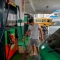 """A man fills a can with fuel at a gas station of Havana, on September 12, 2019. - President Miguel Diaz Canel blamed the United States on Wednesday for Cuba's fuel shortage. In his address, he said the """"low availability of diesel"""" will affect transport, merchandise distribution and electricity generation. The US Treasury Department has imposed sanctions on various companies for transporting Venezuelan petroleum to Cuba. (Photo by YAMIL LAGE / AFP) (Photo credit should read YAMIL LAGE/AFP/Getty Images)"""
