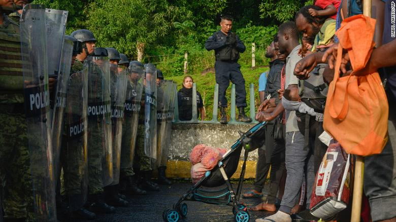 Migrants confront members of the National Guard near Tuzantan, Chiapas state, Mexico, Saturday Oct. 12, 2019. Hundreds of migrants were arrested by Mexican authorities as they made their way to Mexico City. (AP Photo/Isabel Mateos)