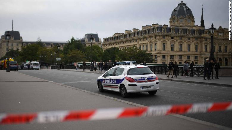 A police drives past a safety cordon near Paris prefecture de police (police headquarters) after three persons have been hurt in a knife attack on October 3, 2019. - A knife attacker was shot and injured after hurting two people at police headquarters in the historical centre of Paris on October 3, sources told AFP. (Photo by MARTIN BUREAU / AFP) (Photo by MARTIN BUREAU/AFP via Getty Images)