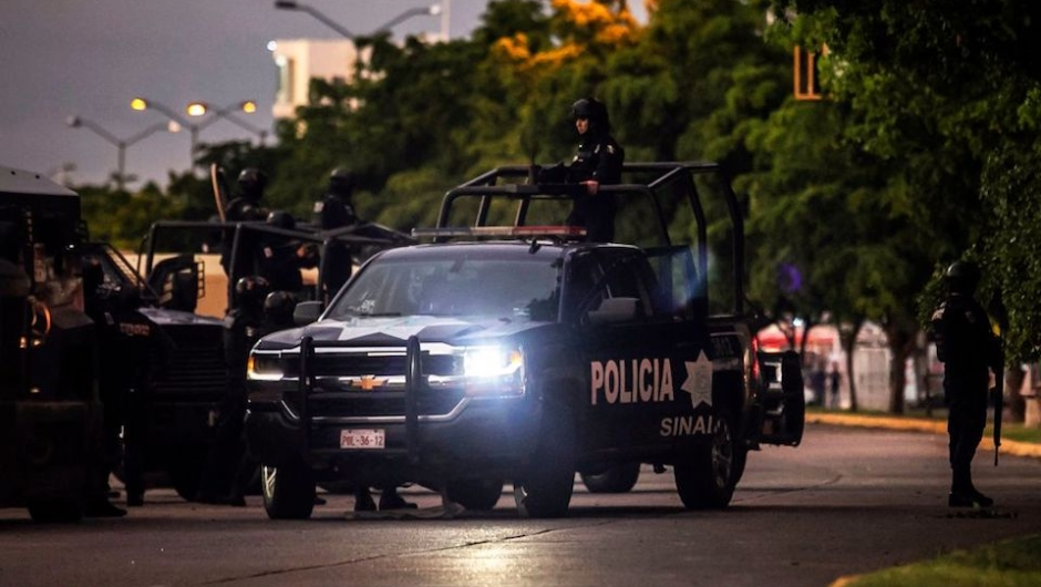 """EDITORS NOTE: Graphic content / Mexican police patrol in a street of Culiacan, state of Sinaloa, Mexico, on October 17, 2019, after heavily armed gunmen in four-by-four trucks fought an intense battle with Mexican security forces. - Mexican security forces on Thursday arrested one son of jailed drug kingpin Joaquin """"El Chapo"""" Guzman in an operation that triggered fighting in the western city of Culiacan, Security Minister Alfonso Durazo said. (Photo by RASHIDE FRIAS / AFP) (Photo by RASHIDE FRIAS/AFP via Getty Images)"""