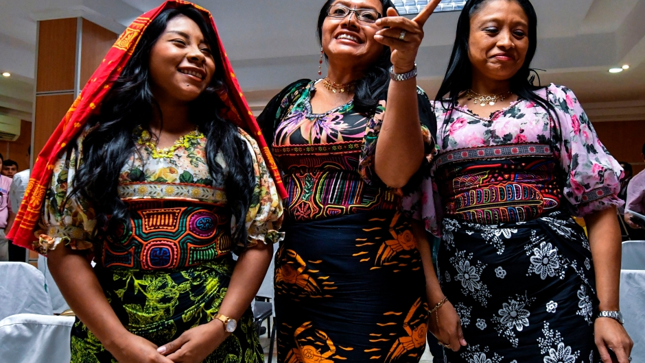 Panama's Guna Yala indigenous women wearing Molas (Guna's hand made textile) attend a press conference in Panama City, on May 21, 2019. - Representatives of natives Guna requested the manufacturer of sportswear and footwear Nike to suspend the launch of a new shoe with a Panamanian Kuna mola print (a hand-made textile) on it, scheduled for next June 6 in Puerto Rico. (Photo by Luis ACOSTA / AFP) (Photo credit should read LUIS ACOSTA/AFP/Getty Images)