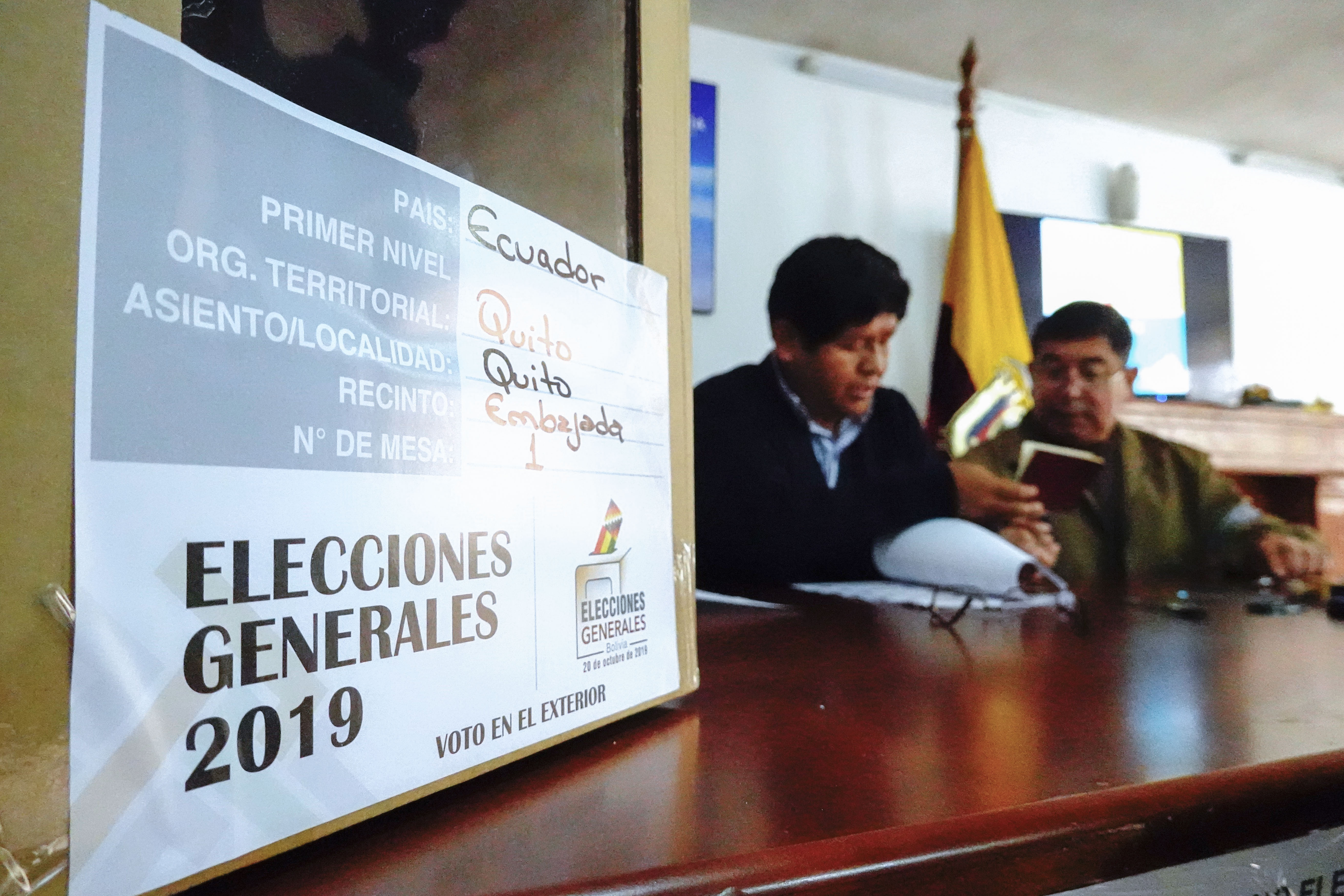 A Bolivian citizen residing in Ecuador prepares to vote during Bolivian presidential elections in Quito, on October20, 2019. - Polls opened in Bolivia Sunday with Evo Morales vying for a controversial fourth term as the country's first indigenous president amid allegations of corruption and authoritarianism. (Photo by RODRIGO BUENDIA / AFP) (Photo by RODRIGO BUENDIA/Afp/AFP via Getty Images)