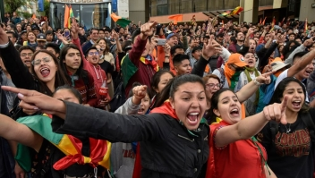 Supporters of Bolivia's main opposition presidential candidate, former president (2003-2005) Carlos Mesa, shout slogans against supporters of president and candidate Evo Morales, as both groups gather outside the hotel where the Supreme Electoral Tribunal has its headquarters to count the election votes, in La Paz, on October 21, 2019. - Evo Morales, seeking a controversial fourth term, led Bolivia's presidential election race Sunday but faces a historic second round run-off against Mesa, partial results showed. Morales had 45 percent of the vote to Mesa's 38 percent, the Supreme Electoral Tribunal announced, with most of the votes counted. (Photo by Aizar RALDES / AFP) (Photo by AIZAR RALDES/AFP via Getty Images)