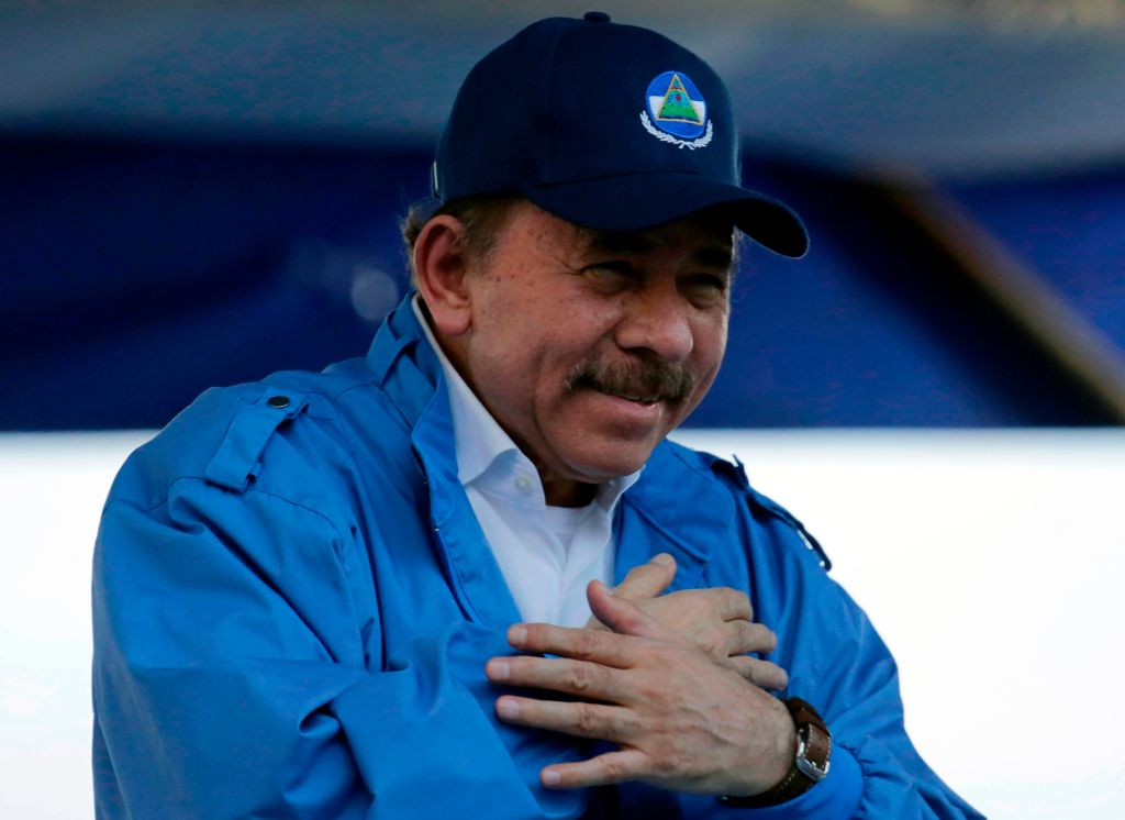 "Nicaraguan President Daniel Ortega gestures during the commemoration of the 51st anniversary of the Pancasan guerrilla campaign in Managua, on August 29, 2018. - Ortega called the UN High Commissioner for Human Rights ""infamous"" and ""terror instrument"", after it denounced Wednesday systematic human rights violations in the framework of opposition protests in which 300 people were killed. (Photo by INTI OCON / AFP) (Photo credit should read INTI OCON/AFP via Getty Images)"
