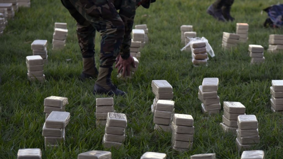 Members of Bolivia's Special Squad against Drug Trafficking arrange a ton of cocaine in packages, seized on the eve near the locality of Baures, during its presentation to the press in Trinidad, El Beni, Bolivia on July 19, 2017. According to official sources the drug was heading to Brazil. / AFP PHOTO / ar / AIZAR RALDES (Photo credit should read AIZAR RALDES/AFP via Getty Images)