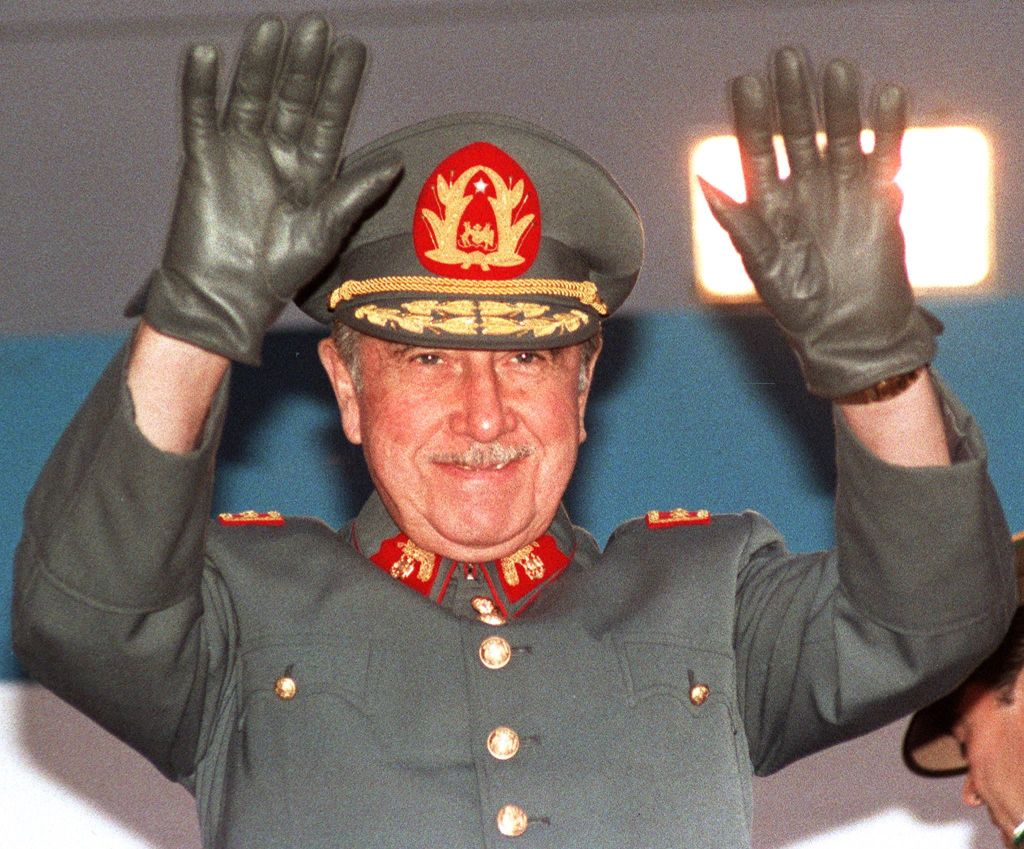 General Augusto Pinochet, then Chilean president, waves to the crowd on October 21, 1986 during a four-day-journey in Antofagasta, northern Chile. / AFP PHOTO / MARCO UGARTE (Photo credit should read MARCO UGARTE/AFP via Getty Images)