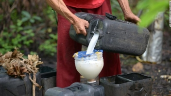 "TO GO WITH AFP STORY ""Philippines-lifestyle-drink-wine,FEATURE"" by Jason Gutierrez In this photo taken on November 15, 2012, tapper Eugenio Andaya, pours his harvest of coconut sap to be used in a local wine called 'tuba' the raw material for Lambanog in Tayabas, Quezon Province, south of Manila. With their huge copper vats and open fires, little-known backyard liquor makers have toiled for generations in Philippine coconut farms to distill the country's answer to Russian vodka. Extracted from the sap of the coconut, the ""lambanog"" was once considered a lowly peasant's drink whose potency they claim puts those of well-known liquors and spirits around the world in the shade. AFP PHOTO / JAY DIRECTO (Photo credit should read JAY DIRECTO/AFP via Getty Images)"