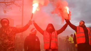 Dockers march with smoke bombs as they take part in a demonstration to protest against the pension overhauls, in Marseille, southern France, on December 5, 2019 as part of a national general strike. - Trains cancelled, schools closed: France scrambled to make contingency plans on for a huge strike against pension overhauls that poses one of the biggest challenges yet to French President's sweeping reform drive. (Photo by CLEMENT MAHOUDEAU / AFP) (Photo by CLEMENT MAHOUDEAU/AFP via Getty Images)