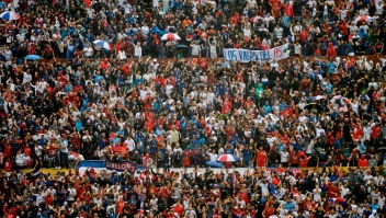 Supporters of Nacional cheer for their team during a Uruguayan football tournament football match against Penarol at the Centenario stadium in Montevideo, on December 15, 2019. (Photo by EITAN ABRAMOVICH / AFP) (Photo by EITAN ABRAMOVICH/AFP via Getty Images)