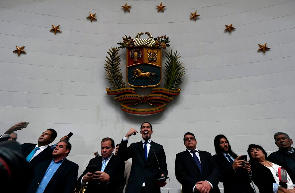 """Venezuelan opposition leader and self-proclaimed acting president Juan Guaido speaks at the National Assembly, in Caracas, on January 7, 2020. - Opposition leader Juan Guaido and a rival lawmaker, Luis Parra -who both had claimed to be Venezuela's parliament speaker, following two separate votes and accusations of a """"parliamentary coup- called for a parliamentary session today. (Photo by Federico Parra / AFP) (Photo by FEDERICO PARRA/AFP via Getty Images)"""