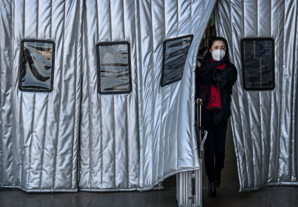 BEIJING, CHINA - JANUARY 23: A Chinese woman wears a protective mask as she leaves a Beijing railway station on January 23, 2020 in Beijing, China. The number of cases of a deadly new coronavirus rose to over 500 in mainland China Wednesday as health officials locked down the city of Wuhan in an effort to contain the spread of the pneumonia-like disease. Medicals experts have confirmed that the virus can be passed from human to human. In an unprecedented move, Chinese authorities put travel restrictions on the city of 11 million and two other neighboring cities, preventing people from leaving after 10 AM local time Thursday. The number of those who have died from the virus in China climbed to at least 17 on Thursday and cases have been reported in other countries including the United States,Thailand, Japan, Taiwan and South Korea. (Photo by Kevin Frayer/Getty Images)