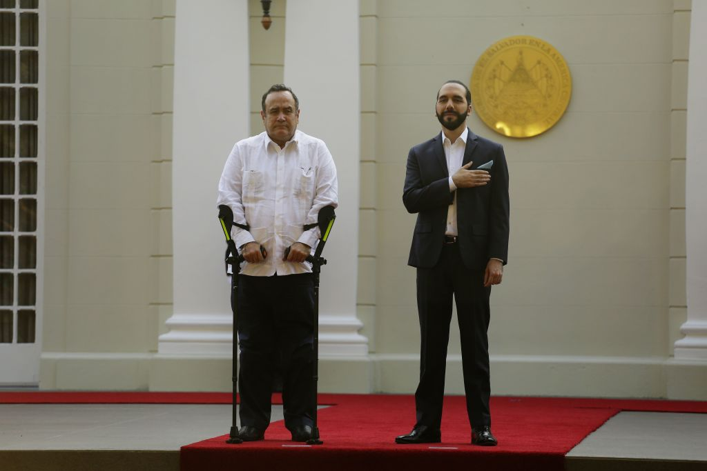 Guatemalan President Alejandro Giammattei (L) and his Salvadorean counterpart Nayib Bukele attend a welcoming ceremony at the presidential palace in San Salvador, on January 27, 2020. (Photo by MARVIN RECINOS / AFP) (Photo by MARVIN RECINOS/AFP via Getty Images)