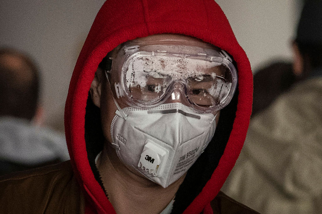 BEIJING, CHINA - JANUARY 30: A man wears a protective mask and goggles as he lines up to check in to a flight at Beijing Capital Airport on January 30, 2020 in Beijing, China. The number of cases of a deadly new coronavirus rose to over 7000 in mainland China Thursday as the country continued to lock down the city of Wuhan in an effort to contain the spread of the pneumonia-like disease which medicals experts have confirmed can be passed from human to human. In an unprecedented move, Chinese authorities put travel restrictions on the city which is the epicentre of the virus and neighbouring municipalities affecting tens of millions of people. The number of those who have died from the virus in China climbed to over 170 on Thursday, mostly in Hubei province, and cases have been reported in other countries including the United States, Canada, Australia, Japan, South Korea, and France. The World Health Organization has warned all governments to be on alert, and its emergency committee is to meet later on Thursday to decide whether to declare a global health emergency. (Photo by Kevin Frayer/Getty Images)