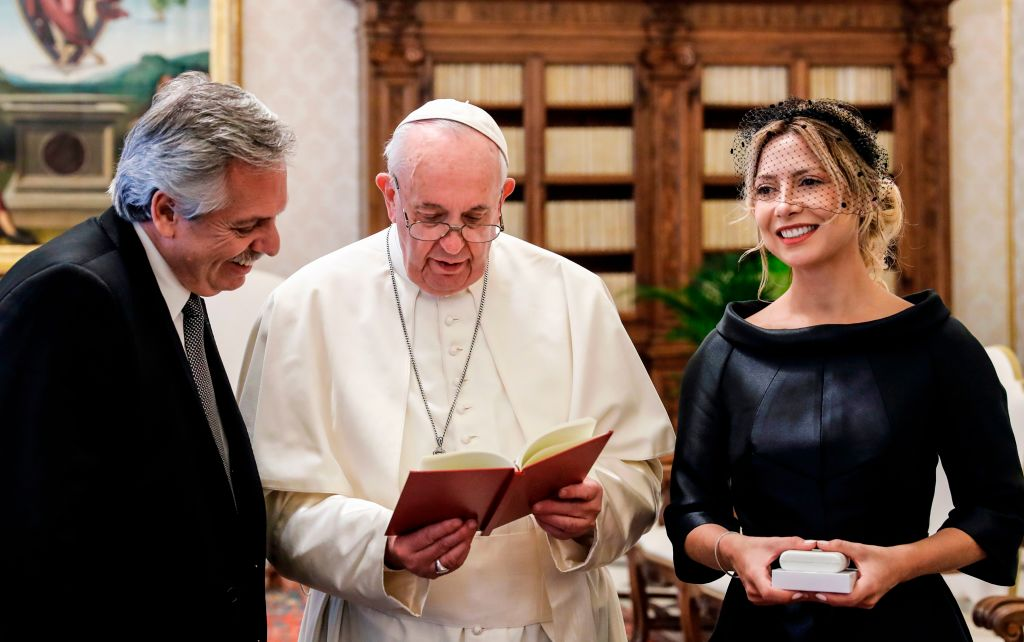 Pope Francis (C) reads a prayer for Argentina's President Alberto Fernandez (L) and Fernandez' partner Fabiola Yanez during a private audience at the Vatican on January 31, 2020. (Photo by REMO CASILLI / POOL / AFP) (Photo by REMO CASILLI/POOL/AFP via Getty Images)