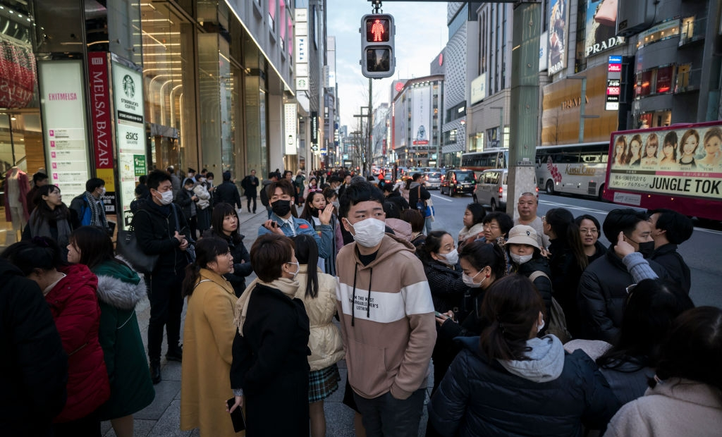 TOKYO, JAPAN - JANUARY 24: Chinese tourists wearing masks walk through the Ginza shopping district on January 24, 2020 in Tokyo, Japan. While Japan is one of the most popular foreign travel destinations for Chinese tourists during the Lunar New Year holiday this year, Japan reported two cases of Wuhan coronavirus infections as the number of those who have died from the virus in China climbed to 25 on Friday and cases have been reported in other countries including the United States, Thailand, Taiwan, Vietnam, Singapore and South Korea. (Photo by Tomohiro Ohsumi/Getty Images)
