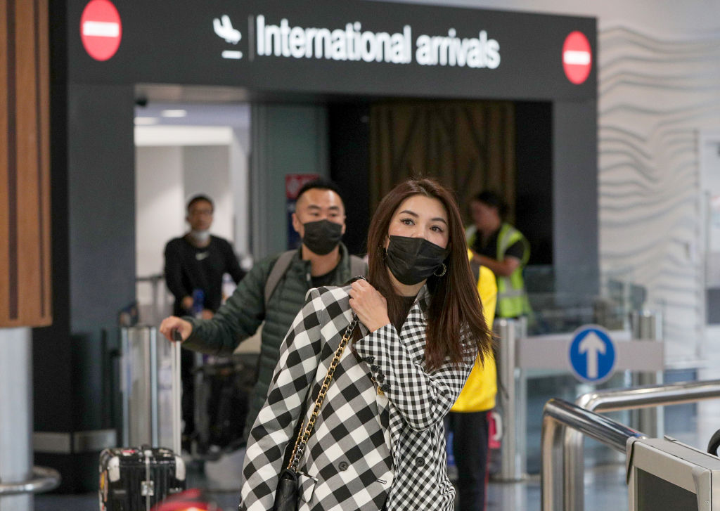 AUCKLAND, NEW ZEALAND - JANUARY 29: Passengers arriving on flights wear protective masks at the international airport on January 29, 2020 in Auckland, New Zealand. There have been no confirmed cases of coronavirus in New Zealand, however health authorities remain on high alert as more cases of the deadly flu-like virus are confirmed around the world. The coronavirus, which originated in Wuhan, China, has now killed 132 people - mostly in China - and as of Wednesday morning had 6,000 confirmed cases while thousands more people remain under observation. (Photo by Dave Rowland/Getty Images)