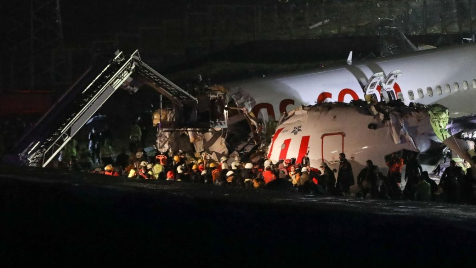 Rescuers work to extract passengers from the crash of a Pegasus Airlines Boeing 737 airplane, after it skidded off the runway upon landing at Sabiha Gokcen airport in Istanbul on February 5, 2020. - The plane carrying 171 passengers from the Aegean port city of Izmir split into three after landing in rough weather. Officials said no-one had lost their lives in the accident, but dozens of people were injured. (Photo by STR / AFP) (Photo by STR/AFP via Getty Images)
