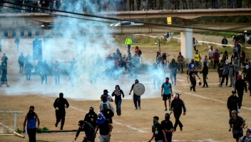 emonstrators are dispersed with tear gas during a protest against Chilean President Sebastian Pinera's government in Vina del Mar, on February 23, 2020, during the Vina del Mar Music Festival. (Photo by MARTIN BERNETTI / AFP) (Photo by MARTIN BERNETTI/AFP via Getty Images)