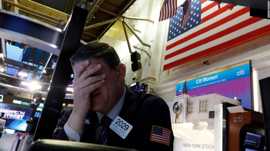 Trader Michael Gallucci prepares for the day's activity on the floor of the New York Stock Exchange, Monday, March 9, 2020. Trading in Wall Street futures has been halted after they fell by more than the daily limit of 5%. (AP Photo/Richard Drew)