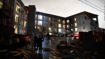 Debris is scattered across the parking lot of a damaged apartment building after a tornado hit Nashville in the early morning hours of Tuesday, March 3, 2020. (Courtney Pedroza/The Tennessean via AP)