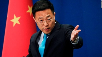 gestures as he speaks during a daily briefing at the Ministry of Foreign Affairs office in Beijing, Monday, Feb. 24, 2020. China???s foreign ministry on Monday said it didn???t matter that three expelled journalists had nothing to do with a Wall Street Journal editorial that Beijing deemed racist, and called on the paper to apologize. (AP Photo/Andy Wong)